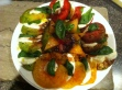 A Caprese salad I made with fresh heirloom tomatoes, fresh buffalo mozzarella, and basil.  It was soooooo yummy!
